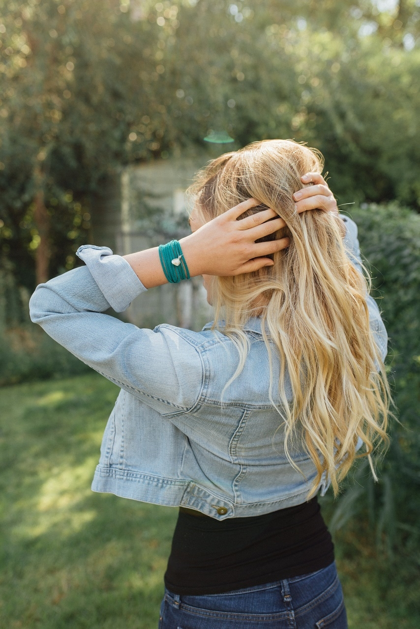 Teal bracelet on model in nature