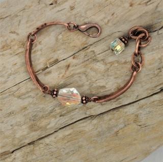 Artisan style copper Swarovski crystal bracelet on wood
