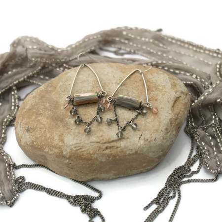 Elegant eclectic earrings on rock with scarf