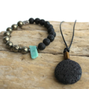 Diffuser-necklace-&-bracelet-with-gemstones-lava-on-wood-background