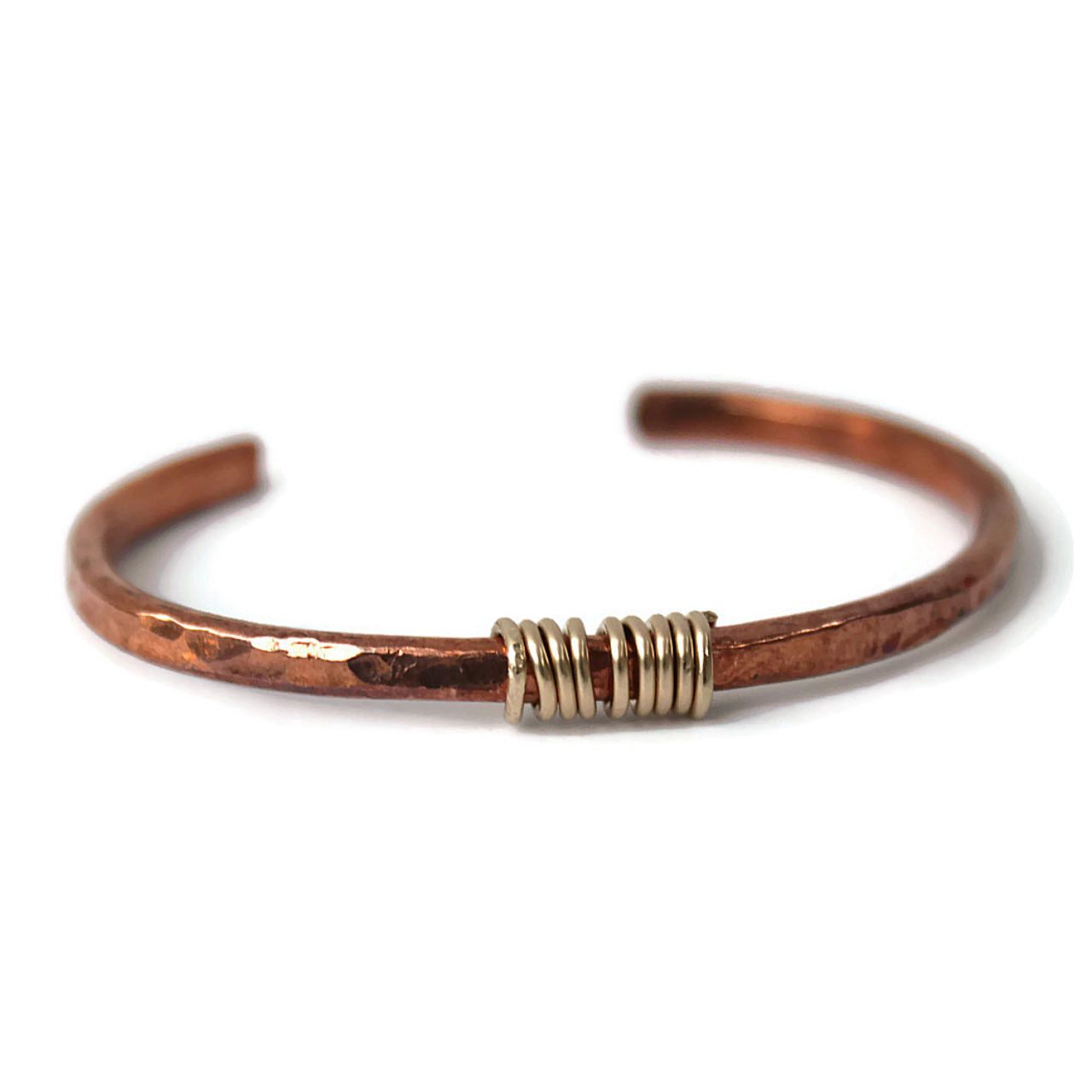 hammered-copper-cuff-gold-wire-center-detail-on-white-background