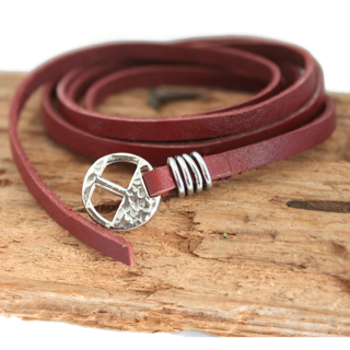 Men's-reddish-brown-multi-wrap-leather-bracelet-silver-slide-buckle-on-wood-background