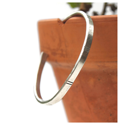 sterling-silver-lined-cuff-bracelet-hanging-on-side-of-clay-pot
