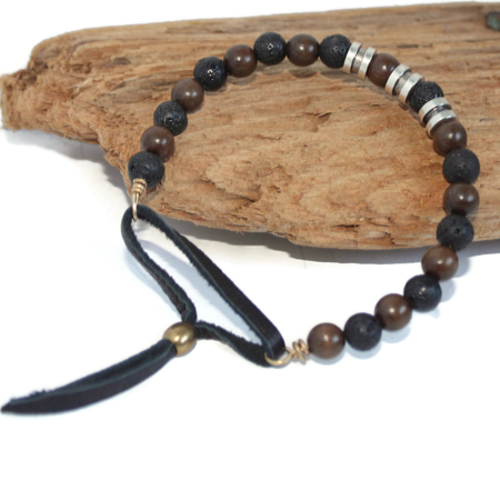 men's-black-leather-brown-wood-black-lava-bead-bracelet-on-brown-wood