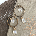 diamond-quartz-chandelier-earrings-with-bronze-hoops-on-tan-linen-and-brown-burlap-background
