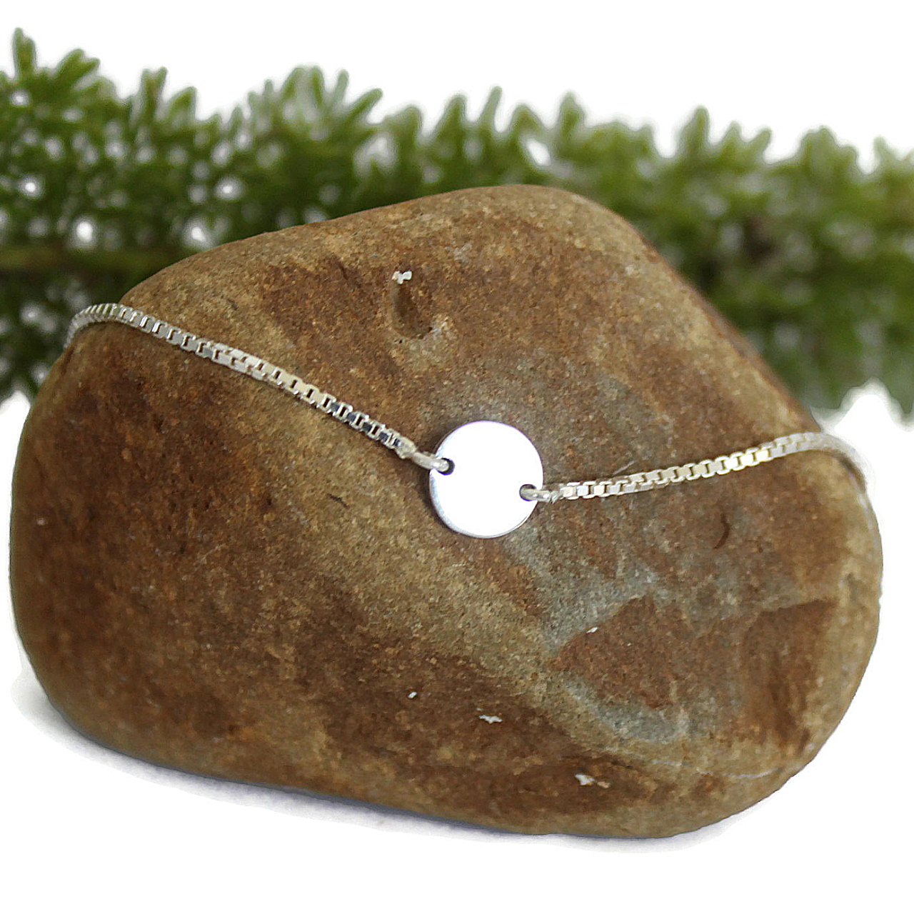 Sterling Chain Bracelet on Rock with Green Plant