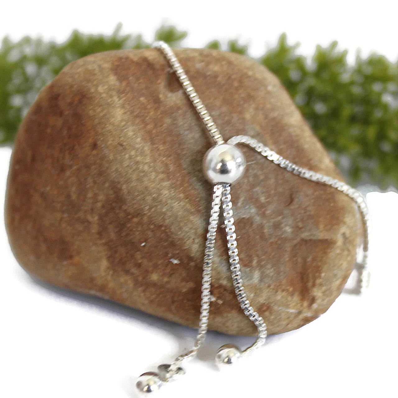 Backside Sterling Chain Bracelet on Rock with Green Plant
