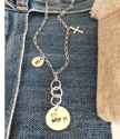 Sterling-multi-chain-mom-charm-necklace-on-denim-background