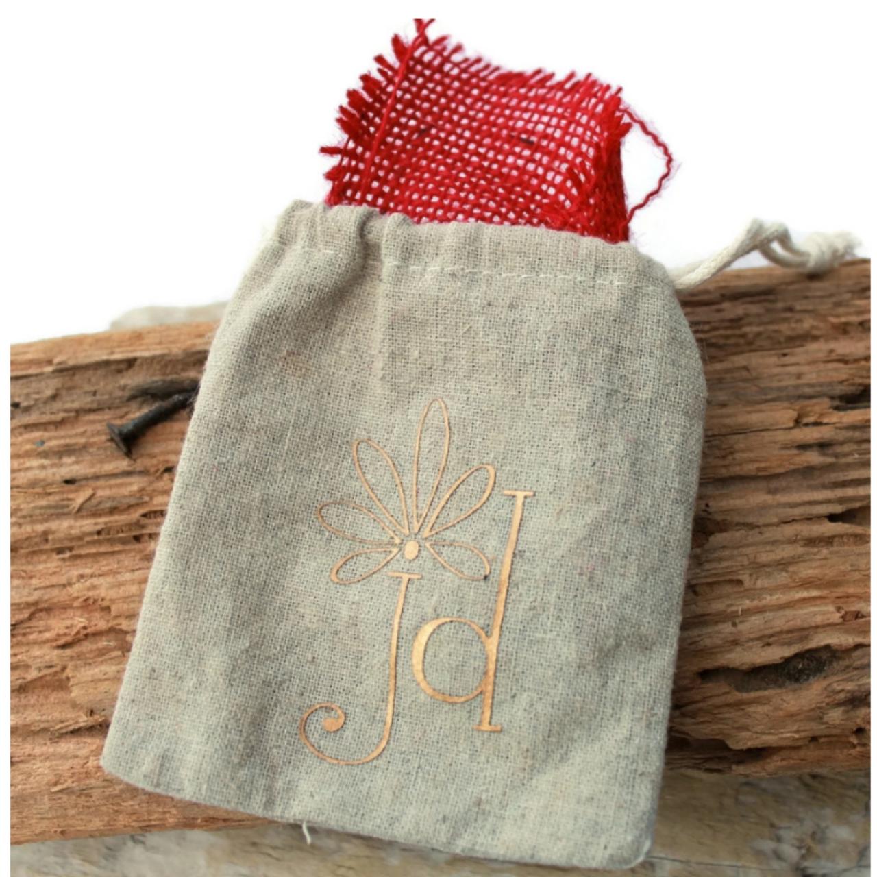 tan linen bag on wood