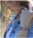 Bronze-wildflower-clear-Swarovski-crystal-statement bracelet-on-model
