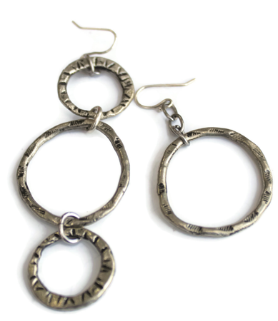 silver-patterened-asymmetrical-hoop-earrings-on-white-background