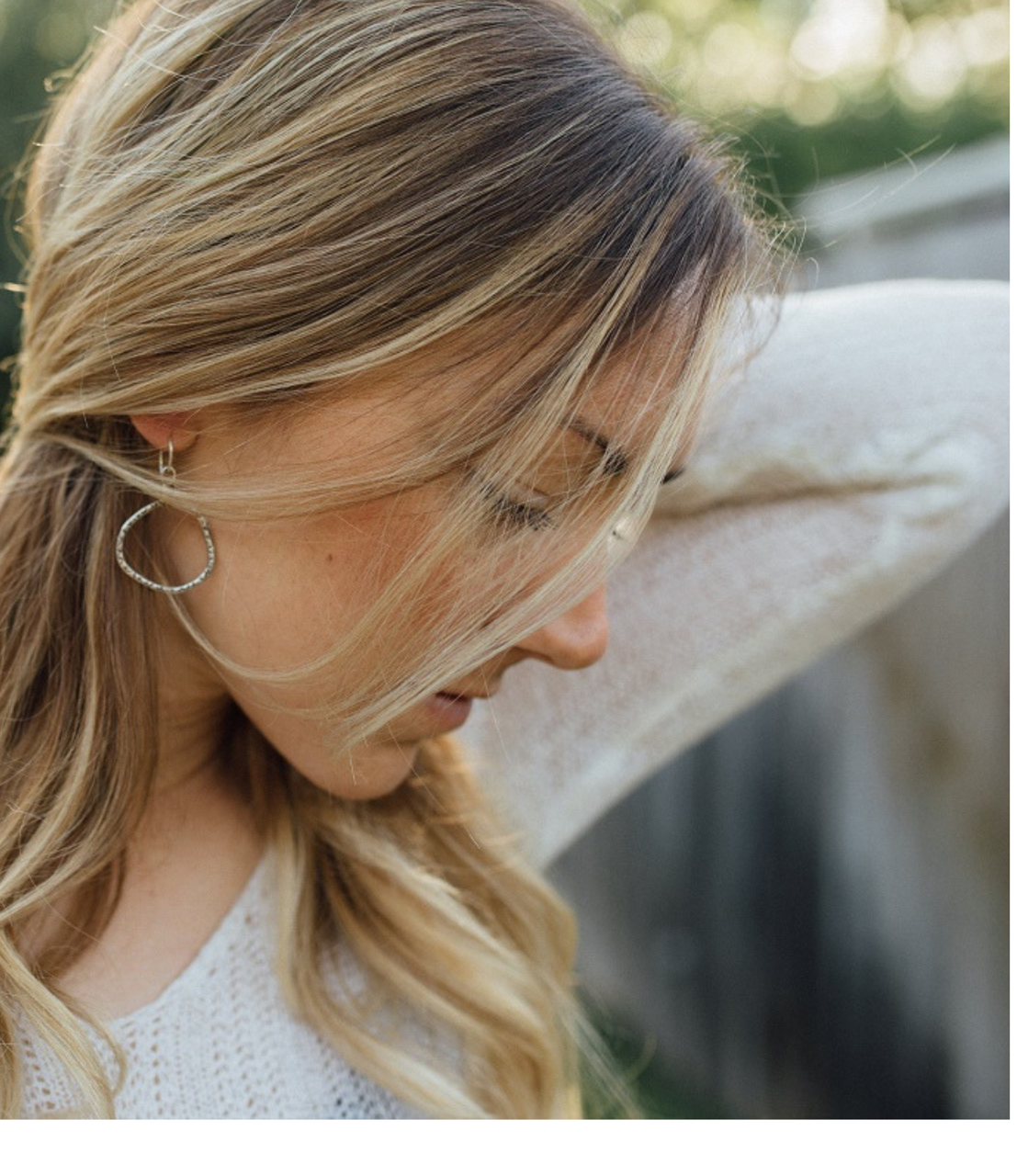 Textured-Hoop-earrings-on-girl-outside-looking-down