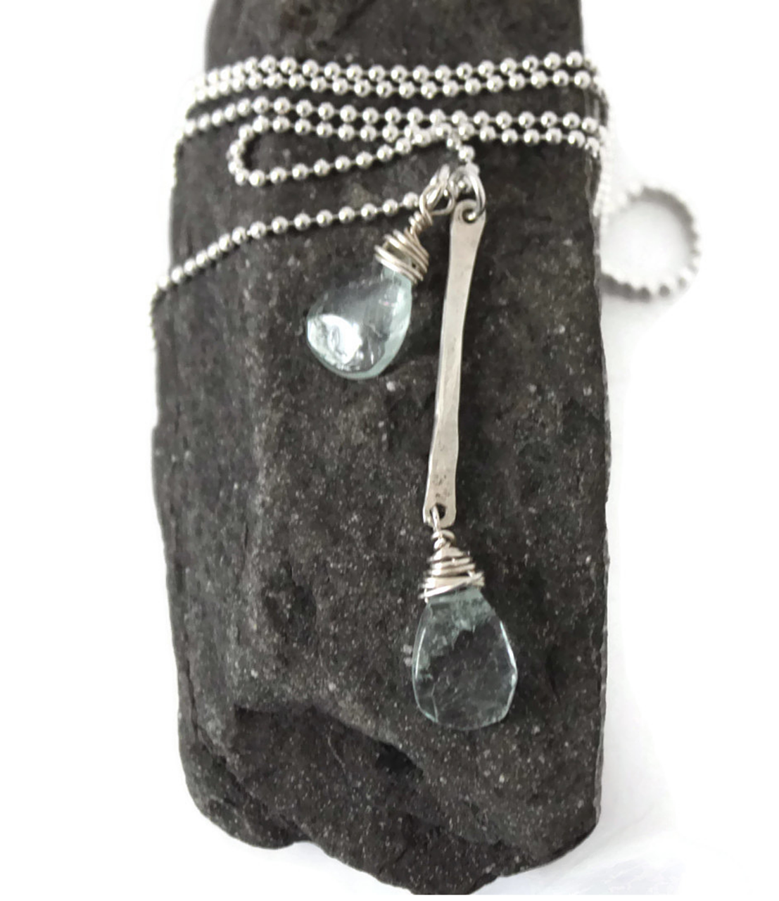 Sterling  aquamarine necklace on rock