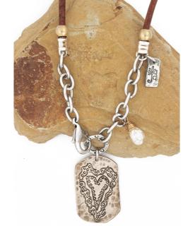 bronze heart necklace on rock