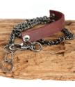 black chain leather bracelet on wood