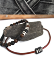 leather necklace beaded bracelet on rock