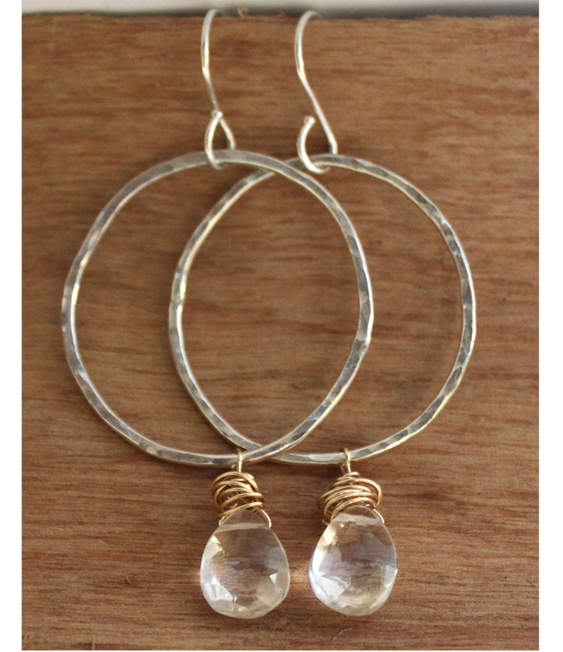 Hoop Crystal Earrings on wood