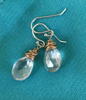 diamond quartz earring on teal background