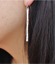 long stick earring on model