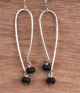 sterling & Black earrings on wood
