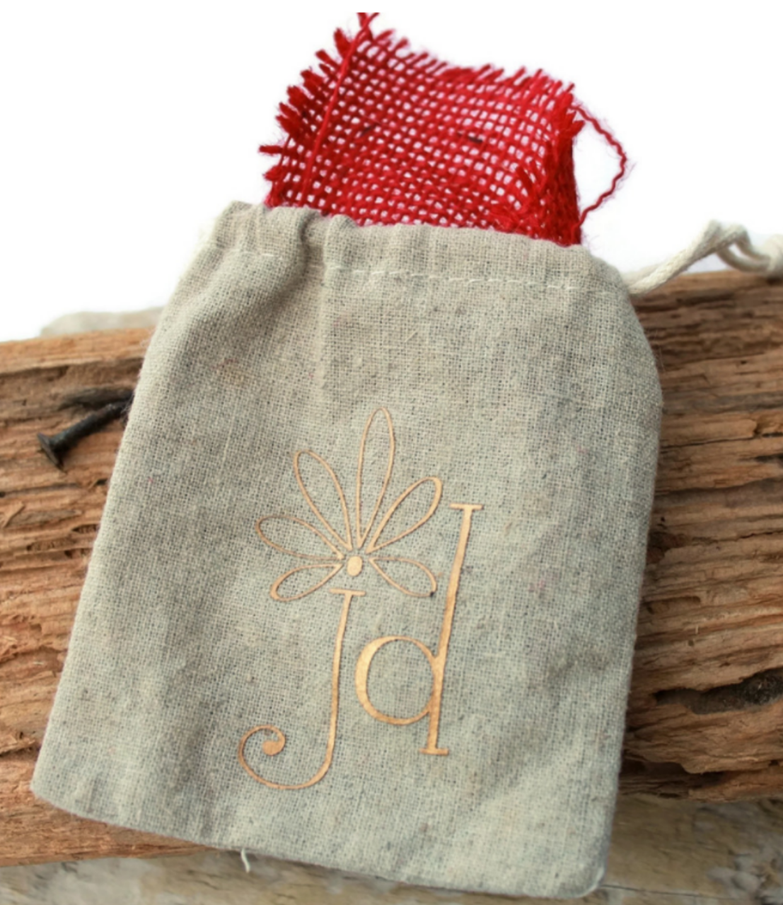 tan-jd-linen-jewelry-bag-red-burlap-liner-on-wood-background