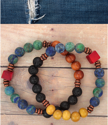 2 beaded bracelets on wood background