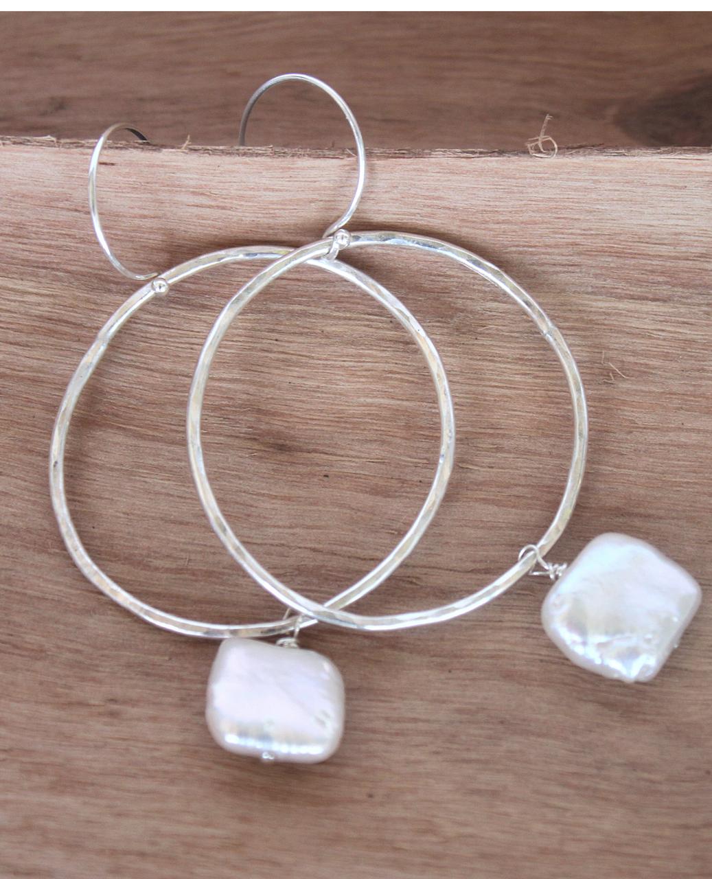 sterling hoop pearl earrings on wood