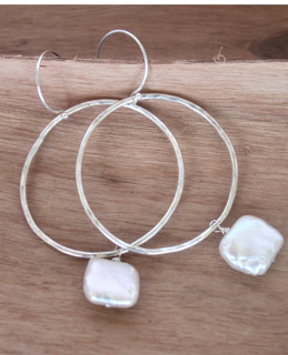 sterling hoop pearl earrings on wood