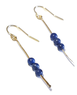 blue stone gold stick earrings on white