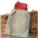 tan linen jewelry bag on wood