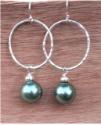 sterling green pearl hoop earrings on wood