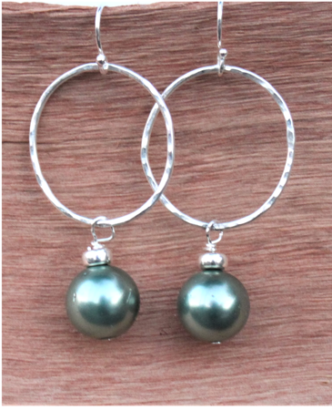 sterling green pearl hoop earrings on wood