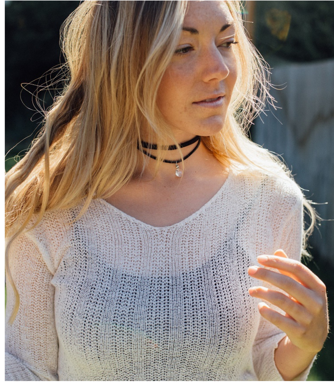 black wrap necklace on model outside