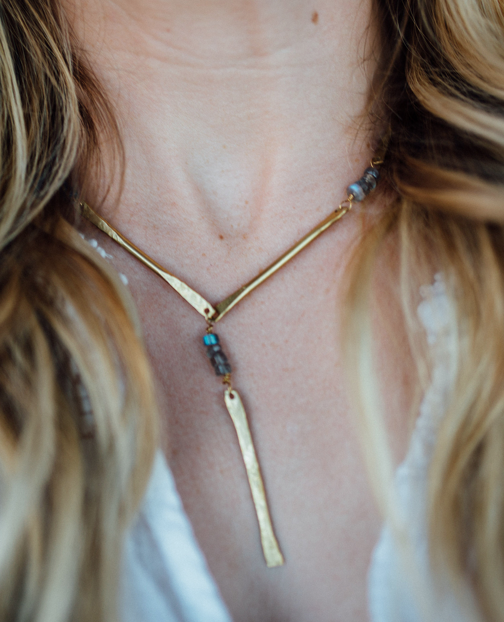 brass necklace on females neck