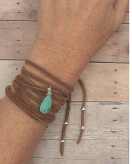 brown suede turquoise wrap bracelet on female wrist