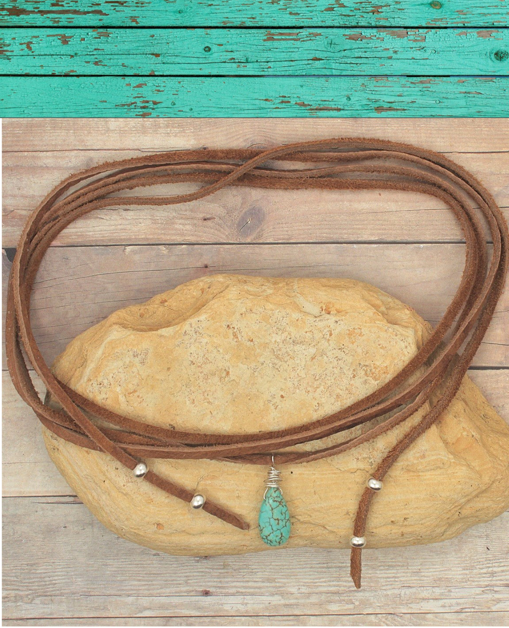 brown suede turquoise wrap necklace on wood