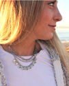 necklace on blonde girl outside