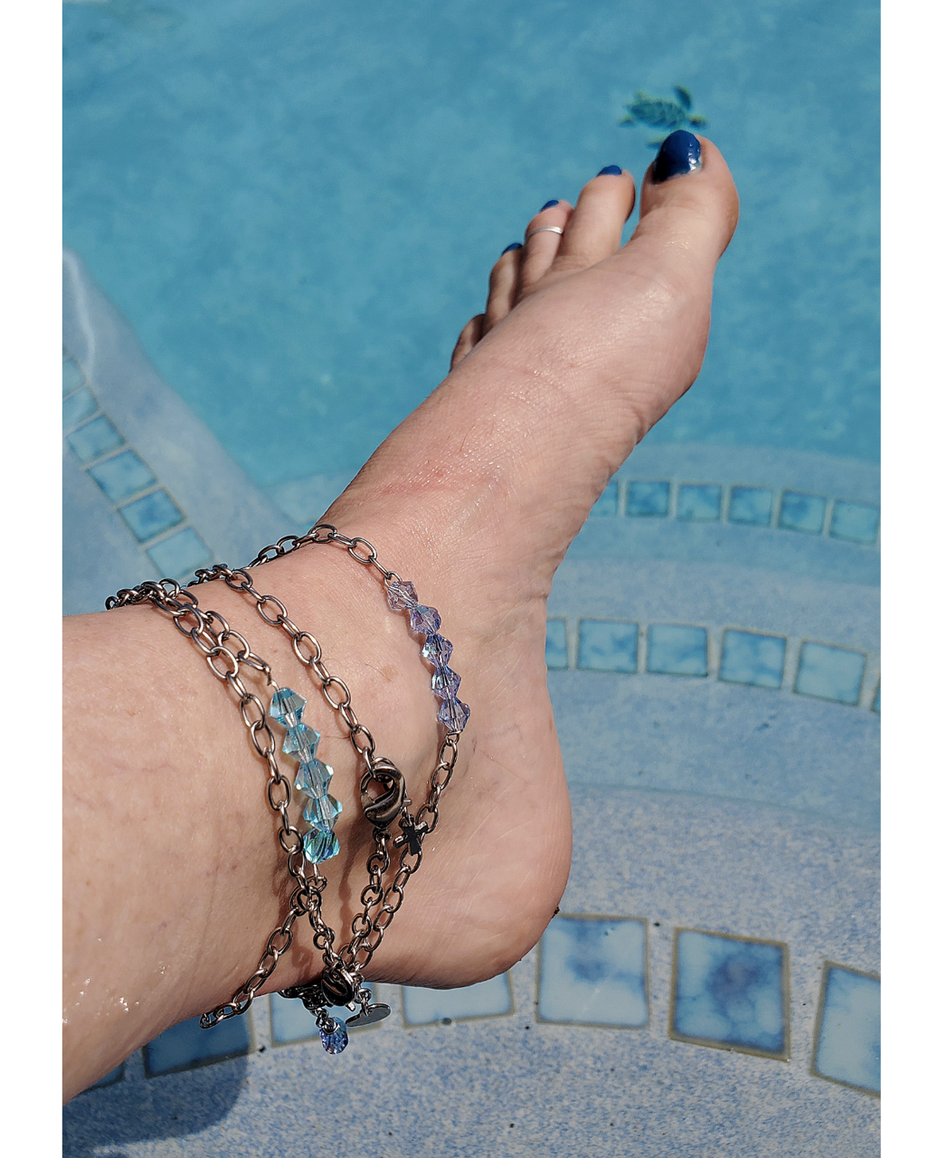 crystal chain anklets on foot in water