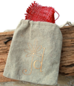 tan linen jewelry bag on wood