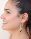 sterling arc earrings on female profile
