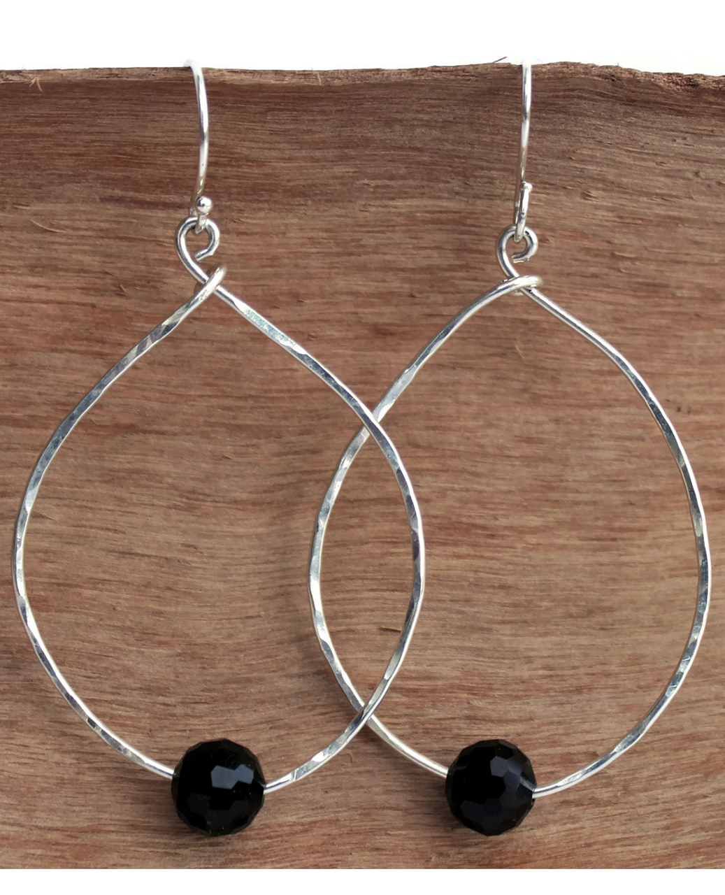 sterling onyx hoops on wood