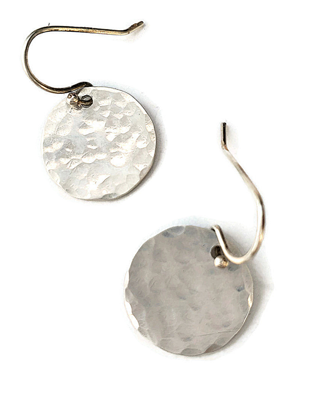 sterling hammered round dis earrings on whiye