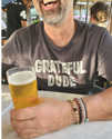 guy with bracelets drinking beer