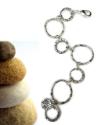 chunky silver circles bracelet next to rocks