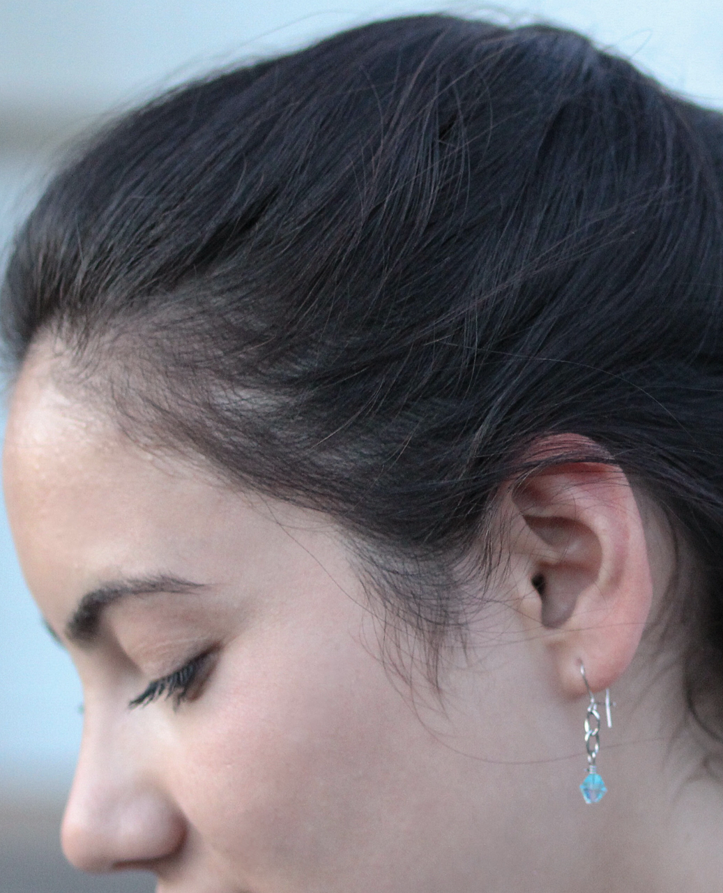 petite aqua crystal earring on female profile