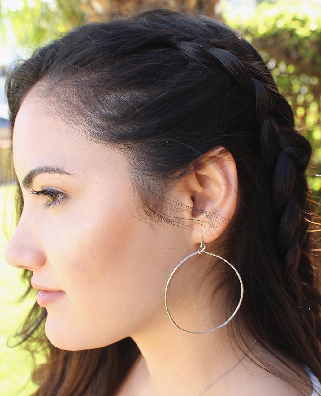 big sterling hoop earring on female profile