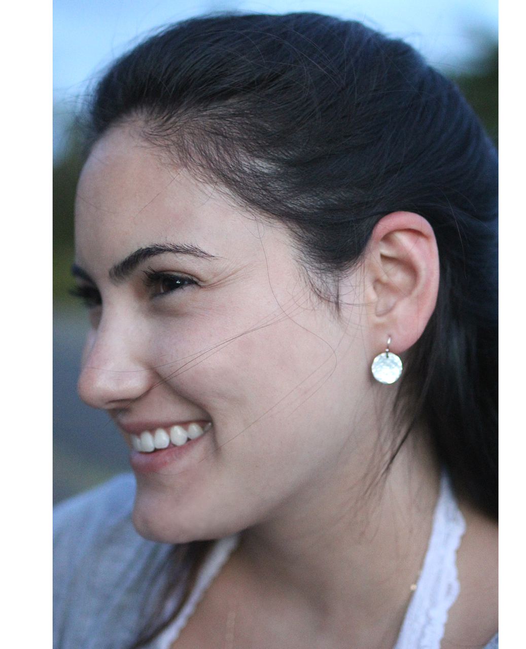 sterling hammered disc earrings on female profile