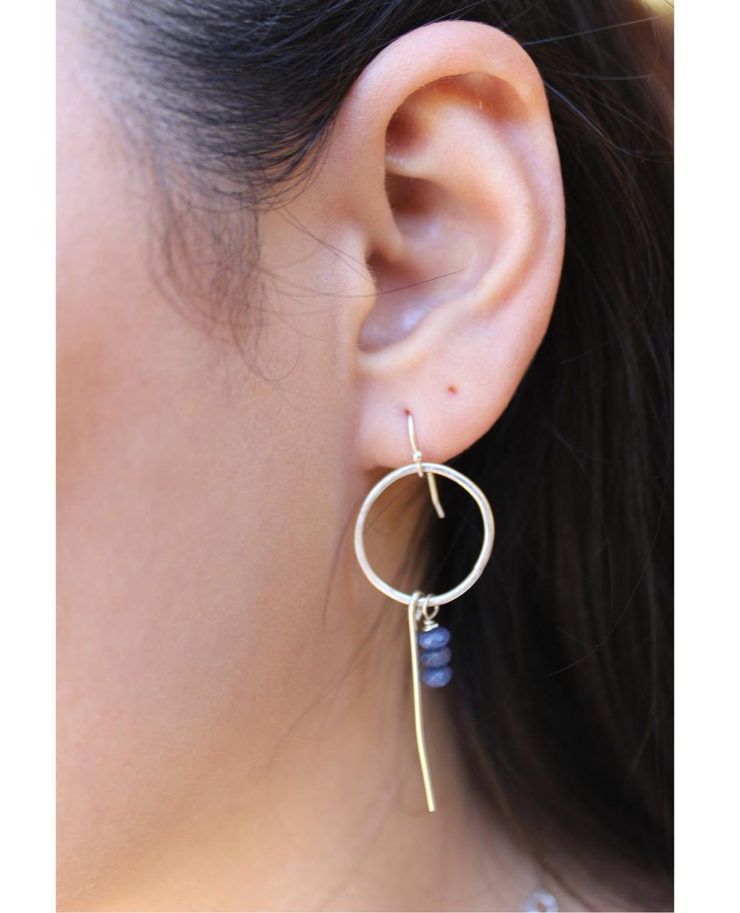 female profile of sterling iolite hoop earrings
