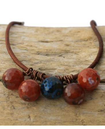 red/blue gemstone leather cluster necklace on wood
