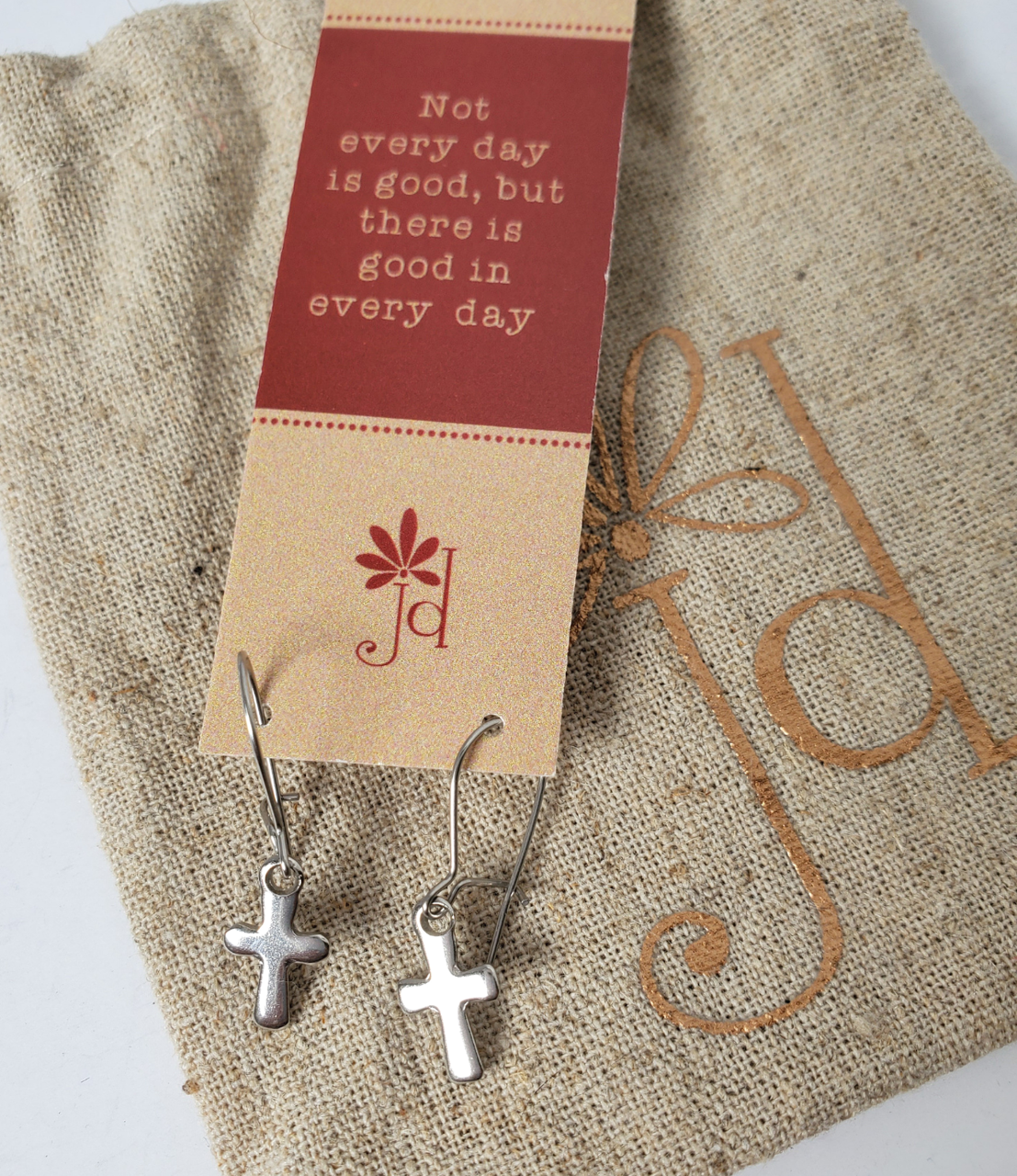 tiny stainless steel cross earrings in onspirational quote card